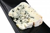 french roquefort soft cheese on black plate