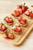 Sweet, tasty sandwich with chocolate and strawberries