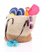 Summer wicker bag with accessories, isolated on white