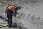 stock photo of sandblasting  - man sandblasting I - JPG