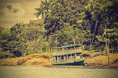 Wooden Boat On The Amazon River, Brazil, Vintage Retro Instagram Style.