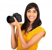happy indian female photographer with a dslr camera