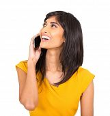 cheerful indian woman talking on cell phone