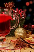 Glass of mulled wine with Christmas decorations