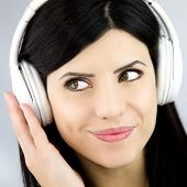 Portrait Of Beautiful Woman With Green Eyes Enjoying Music