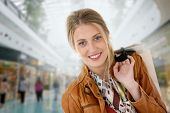 Portrait of smiling girl in a shopping mall