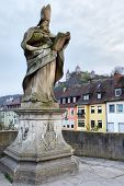 Statue on Old bridge (1730 A.D.) in Wurzburg, Germany