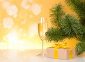 Christmas-tree branch with champagne and gift box