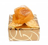 Beautiful Gift Box In Gold Paper With A Silk Rose Isolated On A White Background