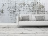 Grunge rustic greyscale interior decor background with a white sofa against a patterned abstract wal
