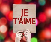 I Love You (In French) card with colorful background with defocused lights