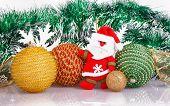 Santa Claus With Christmas Balls And White Snowflakes