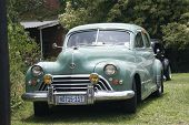 Green Vintage Oldsmobile Car Displayed At Show