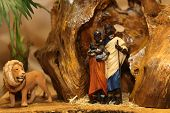 picture of nativity scene  - Nativity scene with Holy Family in a manger with Lion