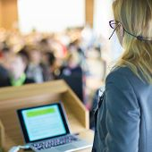 stock photo of speaker  - Female speaker at Business Conference and Presentation - JPG