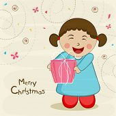 Cute little girl with gift box celebrating the occasion of Merry Christmas on stylish background.