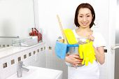 Japanese woman cleaning of bathroom