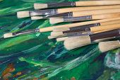 Set Of Paint Brushes On Oil Paints