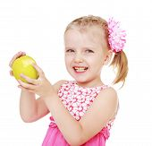 image of little girls photo-models  - beautiful cheerful girl with a big green apple - JPG