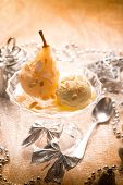 ice cream and pear over christmas table, selective focus