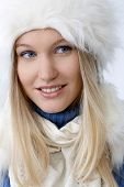 Closeup portrait of smiling young woman at wintertime.