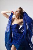 Sexy woman in fluttering blue dress
