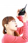 Japanese woman looking at her empty wallet empty wallet
