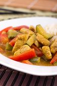 thai red curry chicken with rice bowl
