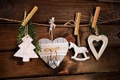Wooden Christmas Decorations Hanging On Twine