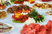 pic of banquet  - Festive banquet table with celebrate delicious food in restaurant - JPG