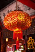 Red traditional Chinese lantern in street