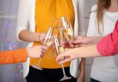 Woman hands with glasses of champagne