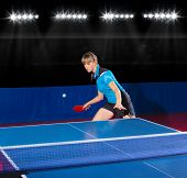 Young girl table tennis player at sport hall