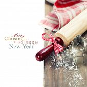making christmas cookies - on wooden background