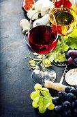 Food background with Wine, cheese and Grape.