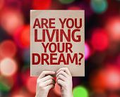 Are You Living Your Dream? card with colorful background with defocused lights