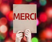 Thank You (In French) card with colorful background with defocused lights