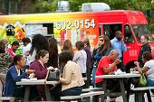 Customers Sit And Eat Lunch Bought From Atlanta Food Trucks
