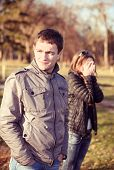 foto of cold-shoulder  - conflict and emotional stress in young people couple relationship outdoors  - JPG