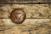 Loaf Of Rye Bread On Old Wooden Table.