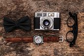 Photography, vintage. Retro camera on the wooden table