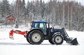 Valtra Tractor Removes Snow With Bucket And Road Drag