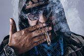 Handsome guy smoke a cigar