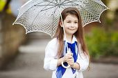 pretty girl with lace umbrella in white suit