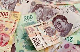 stock photo of pesos  - Mexican Pesos bank notes currency bills money background - JPG