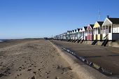stock photo of beach hut  - Southwold beach huts and beach Suffolk England - JPG