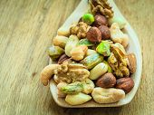 foto of mixed nut  - Healthy organic nutrition high fatty acids food and cuisine - JPG