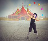 stock photo of circus tent  - Jester clown in front of circus tent - JPG