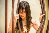 picture of bend  - Asian Thai girl is bending the prison bar with her power - JPG