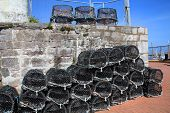stock photo of trap  - Lobster traps and crab pots at a dock in Brixham - JPG